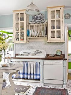 A Home Makeover with Antique Decor - To make this formerly modern kitchen look vintage, the owner hung custom cupboards above a vintage - Shabby Chic Cabinet, Shabby Chic Kitchen, Vintage Kitchen, Vintage Sink, French Kitchen, Rustic Kitchen, Minimalist Kitchen, Minimalist Bedroom, Minimalist Decor