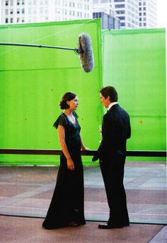 Maggie Gyllenhaal and Christian Bale on the set of The Dark Knight, directed by Christopher Nolan (2008).