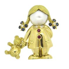 Fred Paris Adorable Pearl Sapphire Diamond Gold Girl with Teddy Bear Brooch | From a unique collection of vintage brooches at https://www.1stdibs.com/jewelry/brooches/brooches/