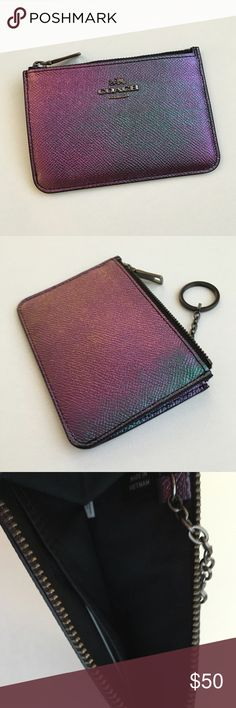 """Coach Hologram Leather Key Pouch Hard to find!! Coach created this magical iridescent hologram finished leather key pouch in purple, blue, green and gold. Because of the color application technique, the colors on every pouch are unique. The color also varies from different angles. Approx. 5""""x3.5"""" with an attached key ring. Gunmetal hardware. Price is firm unless bundled. New, but tag is not attached. Coach Accessories Key & Card Holders"""