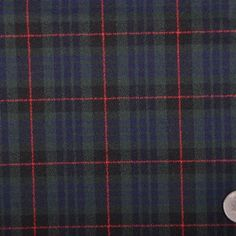 This is a medium weight, heavy stretch, wool blended plaid.