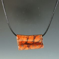 Ceramic Pendant / Necklace in Copper Lava Glaze / Handmade Stoneware Clay. $14.00, via Etsy.