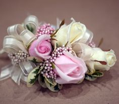 Sweetheart rose corsage with pink rice flower. By Caruso & Company