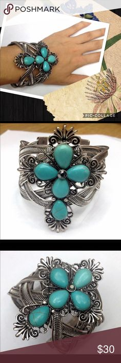 Vintage inspired cuff bracelet Boho statement piece. Very 70's retro vibe. Faux turquoise and antiqued silver tones. Light weight and adjustable fit. Gorgeous piece to accent almost any look! gypsi Jewelry Bracelets