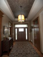 Luna Tray Ceiling Featured in the 2011 MCHB  Showcase of HomesHere is a great example of adding a warm color to the ceiling which makes a large room cozier.  In most cases adding color alone will change the area, this is also cost effective, small steps can give big results.
