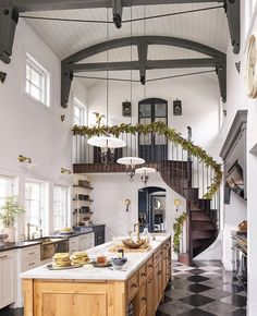 big modern kitchen with staircase and indoor balcony in a spanish style house #kitchendesign #bigkitchen #modernkitchendesign #spanishstylehomes