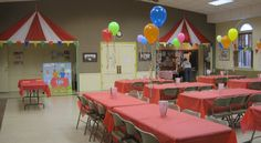 Fellowship Hall set for dinner.  Tent toppers on wall made with roll plastic.