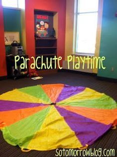 """Program Idea: Parachute Playtime ~ for """"harvest"""" storytime. Grown-ups hold the parachute up while the toddlers crawl underneath. Use cut out leaves of various colors and throw them on the parachute while singing a fall song about leaves falling. Parachute Songs, Parachute Games For Kids, Movement Activities, Music Activities, Preschool Activities, Motor Activities, Preschool Music, Teaching Music, Toddler Storytime"""