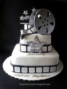 The Bridal shower: film reel cake but change this to camera film and graduation