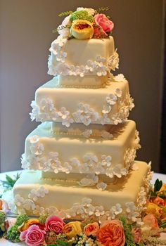 Four tiered square wedding cake with real flowers.  www.carriescakes.com