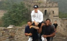 Justin Bieber rested comfortably on the shoulders of his two bodyguards as they carried him up to the Greeat Wall of China