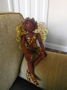 Hey, I found this really awesome Etsy listing at http://www.etsy.com/listing/129076070/dumisani-african-butterfly-faerie-his