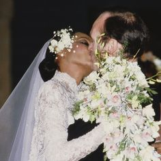 Diana Ross marries Arne Naess Jr. in a pearl-embroidered dress with antique Belgian lace, 1986.