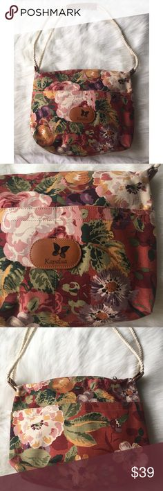 """1 hr sale ⏰Kapalua floral butterfly logo  canvas This gorgeous tote came from the Kapalua Resort in Kapalua, HI. Quality canvas with rope straps and their signature butterfly logo on leather. Excellent condition! 15"""" wide, 13"""" tall, 15.4"""" strap drop. 2 front pockets and 2 large pockets on back. Bags Totes"""
