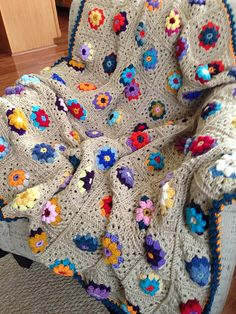 This pattern starts with the flower motif, has a round of shaping to make it a square, and then it is a straight granny square stitch from then on, so you can easily make it as big as you want!