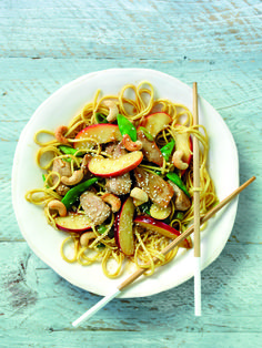 Ingredients250g pack dried medium egg noodles 2 tbsp vegetable oil 40g unsalted cashew nuts 1 pork fillet (weighing about 350g), cut into strips or thin slices 6 spring onions, sliced 2 sticks celery, sliced 100g mangetout or sugar snap peas, halved 2 South African Royal Gala apples, core