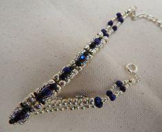 Cobalt Blue Silver Black bead woven bracelet by TheVelvetMannequin