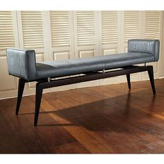 This stylish bench features a grey quilted cowhide leather upholstery. The legs are made with black lacquer hardwood and the bench is finished off with polished nickel details. Great for using at the