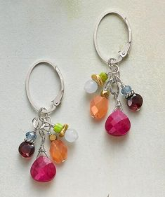 A gathering of vibrant gemstones catches the eye on these 'Pretty Posse' drop earrings.