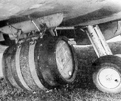 A close up photo of a Spitfire Mk IX With Bomb Pylons Modified To Carry Kegs Of Beer