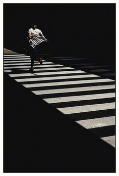 Hamamatsucho, Tokyo, Japan. This photo works because of the leading lines that, despite going horizontally, point towards the person running. The black and white work well for this too because they contrast so much.