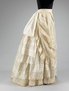 1883 - Met Museum calls this a petticoat but I can't. It looks like a light linen summer skirt. Petticoats don't have a front apron like that.