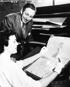 Walt Disney with Marcia Sinclair in the making of Alice in Wonderland, 1949. They are in the Ink and Paint Department, where animator's drawings are transferred onto acetate and painted.