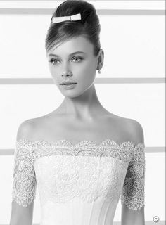 side-swept updo hair with white bow