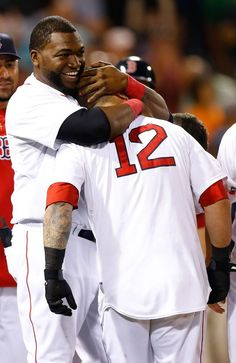 BOSTON, MA - JULY 22: Mike Napoli #12 of the Boston Red Sox is congratulated by David Ortiz #34 of the Boston Red Sox at home plate after hitting a walk-off home run in the 11th inning against the New York Yankees during the game on July 22, 2013 at Fenway Park in Boston, Massachusetts. (Photo by Jared Wickerham/Getty Images)