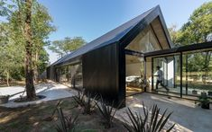 Exterior, Metal Roof Material, House Building Type, Metal Siding Material, and Gable RoofLine Extensive glazing and skylights fill the home's interior with natural light. Modern Barn House, Black House Exterior, Black Barn, House Siding, Box Houses, Shed Homes, Metal Homes, Modern Architecture, Building A House