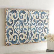 In ceramics, tiles often have decoration inlaid into their surface using clay of a contrasting color.Our beautiful blue and white acrylic on canvas evokes the feel of a well-weathered Mediterranean ceramic tile that'll be a breath of fresh air in any setting.