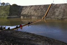 The Moses Bridge in Netherlands is constructed out of Accoya wood, a hi-tech wood that is supposedly harder and more durable than some of the best tropical woods. It is treated with a nontoxic anti-fungal coating to maintain its split-the-water functionality.