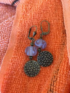 Lovely lavender lamp work swirled earrings with brass accents by RealBeadDesigns on Etsy