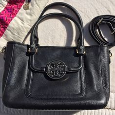 """Tory Burch Mini Amanda Satchel, NWOT A versatile style with pebbled leather finished, double top handle (6"""" drop), & adjustable, removable crossbody strap (fully extend to 22""""). NWOT, protective stickers still on bottom studs & interior metal logo. Features top zipper closure, front pocket under logo flap, back slit pocket, 1 Interior zipper pocket, 2 additional open pockets, logo jacquard lining. Includes dust bag. Last image is adapted online for size reference. Also note a slight creasing…"""