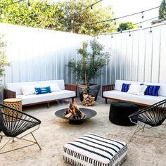 This backyard uses sheet metal for the fence. It's a lot of sheet metal - too much for my taste - but it gives you an idea of what can be done.