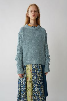 Hila cable dusty blue  - Ribbed crew neck, cuffs, and hem Plain knit body Cable knit sleeves Offset shoulder seams Fully fashioned details 100% Cotton