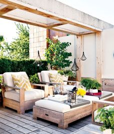 Outdoor decor: Modern rustic backyard - Style At Home.  I love this, and I'm thinking this sort of set up can replace my deck table and chairs.  Who wouldn't love to eat dinner here?