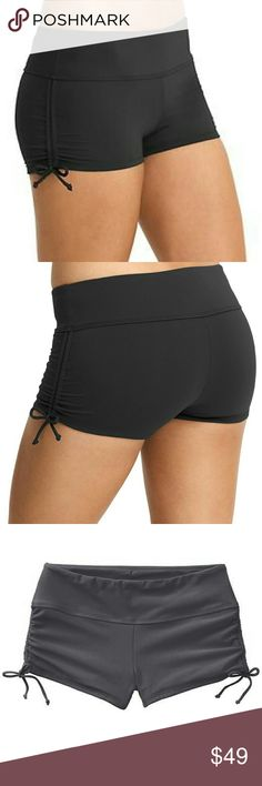 """Athleta gray scrunch short NWT Brand new with tags.  This favorite style of Athleta features an exterior gray color with peach interior color.   INSPIRED FOR: swim/surf/paddle, run, gym/training Ultra-comfortable wide waistband Internal drawstring for a custom fit Adjustable side cinches let you expose more or less leg Versatile for both water and land sports alike  Size small Material: shell 75%nylon 25%spandex, Lining 100%polyester Length approx 8.5"""", rise approx 7"""", inseam approx…"""