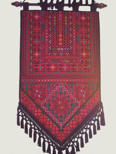 Beautiful Palestinian Bedouin embroidered wall hanging. The cross stitch embroidery is fully handmade by Bedouin women.    Width 32 cm x height
