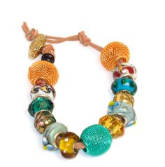 The perfect casual bracelet: Euro bead style bracelet has Metal mesh beads, faceted glass beads, ceramic beads on 2 strands suede  Easy-peasy, cool, modern Euro bead style bracelet. A wide variety of beads in two vibrant, fresh colors make this bracelet an instant winner! The aqua and gold are bright, cheerful, casual. The mesh beads are big, bold, fun. The glass beads add just a touch of class and some sparkle.