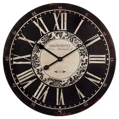 "William Wall Clock - Welcoming Warmth on Joss & Main. Made of engineered wood and metal. Features a Roman numeral dial, typographic accents, and a black and white weathered finish. 23.25""Diameter. $39.95"