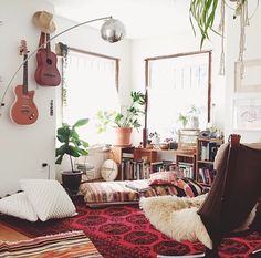 notice: Bright rug, plants, and ukulele on the wall. We should do this, too.