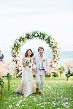 Bride and groom looking radiant in matching white as they celebrate the start of their journey together as man and wife // Bryan and Su Mae's focus for their Koh Samui wedding was to give their guests the best time of their lives, and so they did! Along with The Wedding Bliss Thailand, the couple organized this blush pink and rose gold-themed wedding at Villa Katrani, which featured the most incredible circular floral arch! Darinimages was there to capture all the fun, candid moments