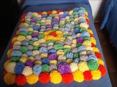 diy tutorial: make a fluffy pom pom rug via dawanda | pom pom