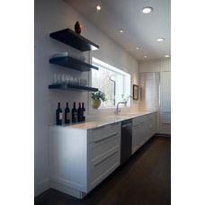 Modern Contemporary Home. Frameless flush cabinets, waterfall island top, quartz counter, stainless tambour.