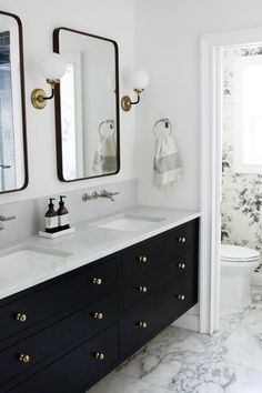 A few weeks ago, we revealed our master bathroom makeover (check out the post here if you haven't already! We just tallied up all the invoices and expenses for our bathroom renovation and we wanted Bathroom Vanity Designs, Bathroom Interior Design, Bathroom Faucets, Black Vanity Bathroom, Bathroom Ideas, Black Cabinets Bathroom, Black And White Master Bathroom, Gold Bathroom, Budget Bathroom