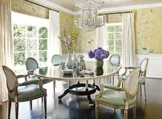 Gorgeous buttery yellow hand painted Chinoiserie wallpaper, light turquoise upholstered Louis XVI chairs, and that fabulous white pagoda chandelier.