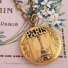 PARIS LOCKET NECKLACE / Eiffel Tower Locket / French Souvenir Themed Jewelry / Picture Locket Necklace /Vintage Style Jewelry /Travel Gift. $34.50, via Etsy.