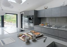 Professional chef Monica Galetti's kitchen has a clean and industrial feel to it, with a bank of integrated Obsidian Black Miele appliances and different CombiSet hobs Modern Large Kitchens, Modern Kitchen Island, Black Kitchens, Home Kitchens, Open Plan Kitchen Living Room, Kitchen Dining Living, Kitchen Hob, New Kitchen, Kitchen Ideas
