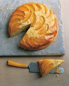Peach and Cornmeal Upside-Down Cake by marthastewart: A relatively effortless, yet elegant, skillet dessert. Aromatic lavender permeates the lightly sweetened cornmeal cake, and plump peaches impart even more fragrance and flavor. #Cake #Cornmeal #Peach